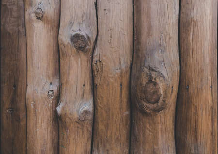 Wooden wall from logs of pine as a background texture. logs are arranged vertically. a wooden palisade Foto de archivo - 131279186