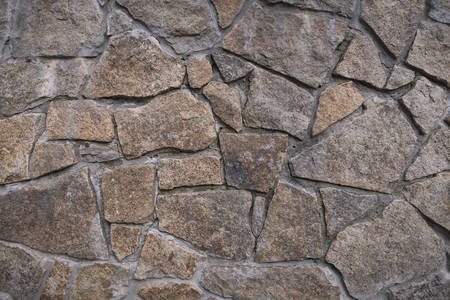Background texture of stone wall. Fragment of wall from a chipped stone