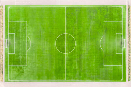 soccer field with lines on grass. real football field aerial view. empty stadium without people