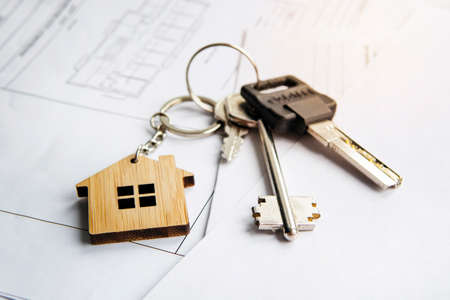 keychain in the form of a house. Model house, construction plan for house building, keys. Real Estate Concept. Top view.