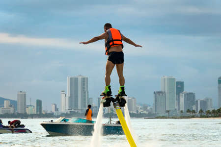 Flyboard. Air Farthest flight by hoverboard. Man flying on Board. Flyboard is aerial machine for personal watercraft, allows propulsion underwater.