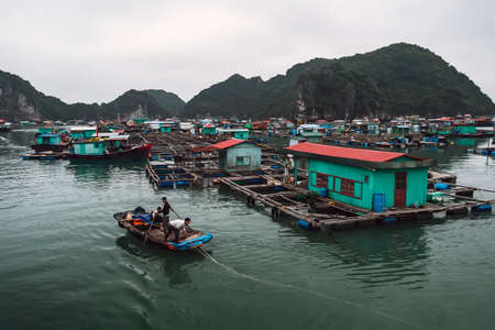 floating fish farm in ha long bay vietnam. production of fish and shellfish in the sea