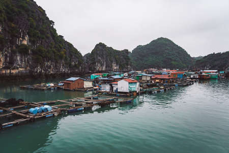 floating fish farm in ha long bay vietnam. poor, indigent. production of fish and shellfish in the sea.