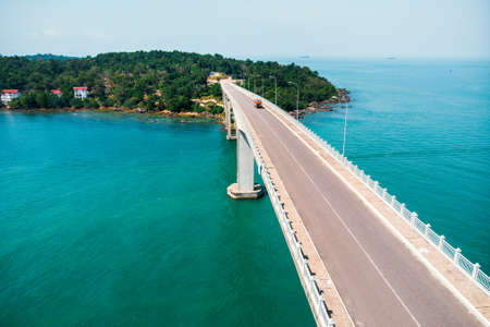 Scenic Aerial View of Bridge over the Sea. bridge TECHO MORAKAT to Snake island KOH PUOS. Sihanoukville. Cambodia. Top view aerial view. Stock Photo