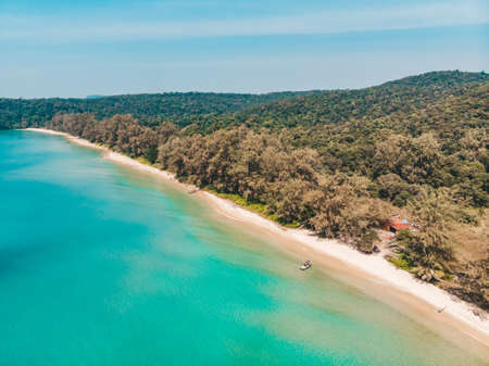 Long deserted beach with white sand and clear water. Aerial top view from above. island Koh Rong Samloem, Sihanoukville, Cambodia. small island that attracts many vi. White sand beach and calm sea.