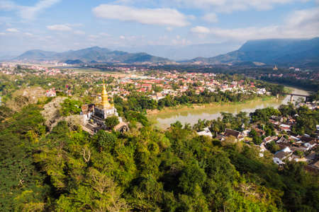 Panorama view of Luang Prabang Laos. top of Phou Si, the hill that dominates the city, popular location for sunrise sunset views. golden stupa on the top of Mount Phou Si Banco de Imagens