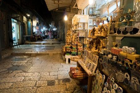 Night shopping street with gift stores for tourist of Jerusalem. Jerusalem, Israel, October 23, 2018 Redakční