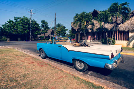 A classic retro car is parked on the road in the resort town of Varadero. Cuba.