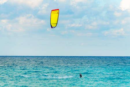 man is kitesurfing in the Caribbean sea in Varadero Cuba.