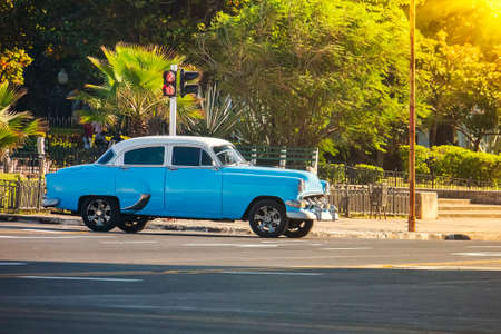 November 26, 2019, Havana, Cuba. Old blue classic American car stands at an intersection in front of a traffic light Zdjęcie Seryjne
