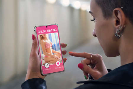 A young attractive girl is looking for a couple in an online Dating app. Search for love on Internet. a girl is looking for a girl. All screen graphics are made up