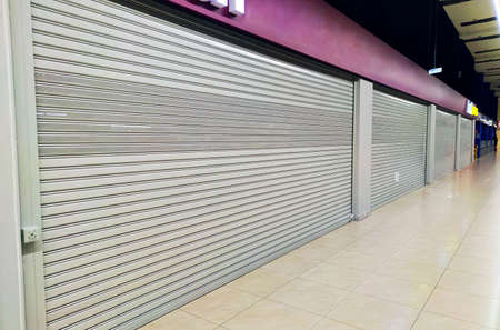 many closed boutiques in Mall during the global quarantine due to coronavirus pandemic. Problems of small businesses and private sellers. closure of shops. Recession and decline in sales in economy.