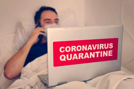 Coronavirus or Covid-19 concept. Business man working from home wearing protective mask. Businessman in quarantine for coronavirus wearing protective mask. Working from home.