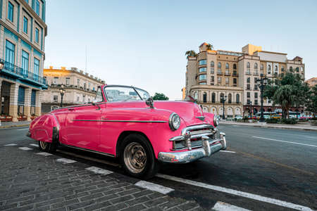 Old American car on streets of capital city of Havana, Cuba. Famous tourist attraction, cars from 50s and 60s.
