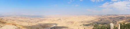 View from top of the Mount Nebo to the Jordanian desert valley. Desert land around the dead sea. panoramic view