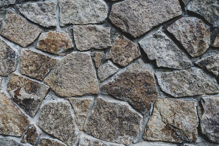 Background texture of stone wall. Fragment of wall from a chipped stone 免版税图像