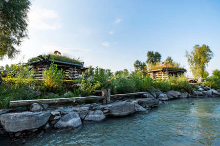 Small log houses for outdoor recreation are located on the river Bank. Hunting ground. Tourist base near the water. agrotourism