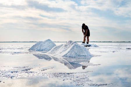 Salt mining on lake burlinskoye. Bursol '. Altai territory. Russia. Salt piles and water pool on Salinas Grandes salt flats