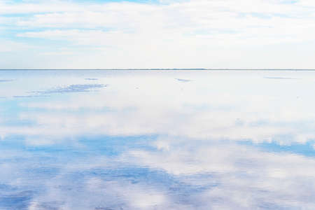Perfect reflection in Salar de Uyuni, Uyuni Salt Flats in Bolivia, incredible mirror-like lake in South America