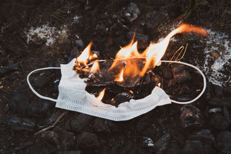 Burning a medical mask, surgical mask with cleansing decontaminate fire