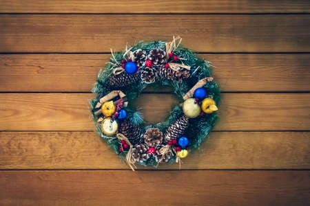 Christmas wreath of cones, spruce branches and berries, New Years decorations. beautiful spruce wreath with cones, balls and fruit.