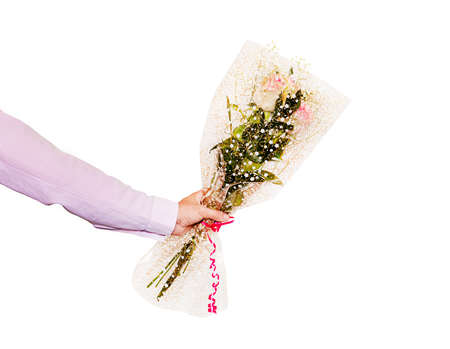 Hand holding a beautiful bouquet with a roses. Isolated on a white background. a man gives a bouquet of roses
