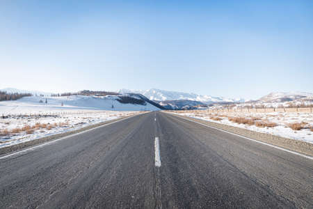 Snow on Highway in a landscape image Banco de Imagens