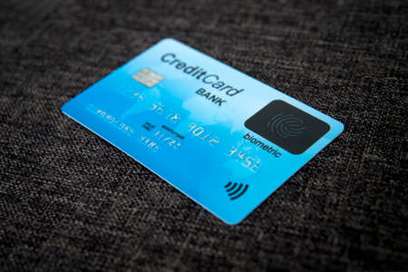 Close up of credit card with new fingerprint recognizing technology at sackcloth material