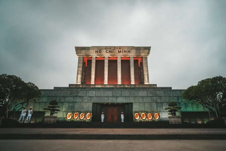 The Ho Chi Minh Mausoleum in center of the Ba Dinh Square in Hanoi, Vietnam. Blue sky in background. The Ho Chi Minh Mausoleum is a popular tourist destination of Asia. 新聞圖片