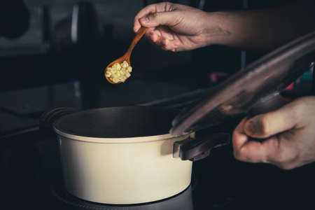 cooking pea porridge in a saucepan on an induction cooker
