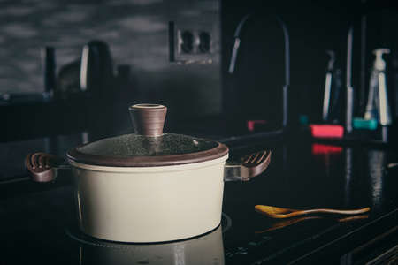 a pot in the kitchen on a black background.