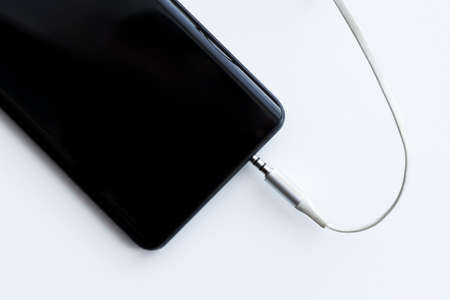 mobile smartphone audio cable jack 3.5mm and input hole on a white background