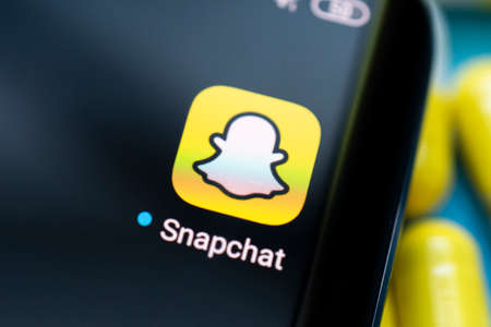 Snapchat app on a black android smartphone screen. April 3, 2021 Barnaul, Russia Редакционное
