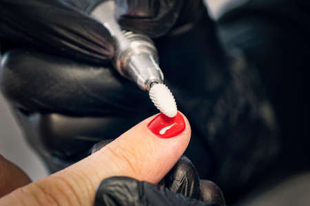 Men's manicure. Design of men's manicure. The master makes a man manicure. The concept of professional nail care. Close-up of the manicurist's hands at work. A man does a manicure.