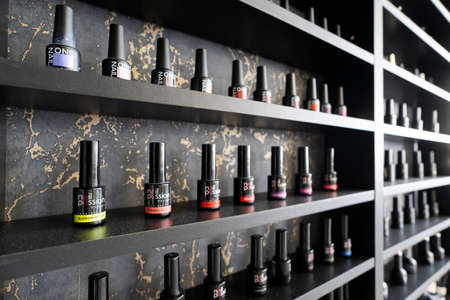 several bottles of nail polish at a beauty shop on the black shelf. April 29, 2021. Barnaul, Russia