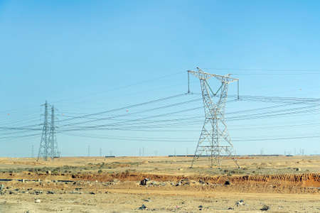High voltage transmission towers in the desert of egypt 스톡 콘텐츠