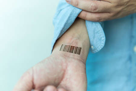 Bar code is on man hand. Clone of DNA and human genome. The concept digital electronic cards, tracking during the pandemic, in quarantine. Mass chipization of the worlds population. Global control,