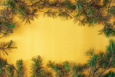 Vintage christmas greeting card. yellow square frame with fir branches. New Year's Christmas decorations Фото со стока