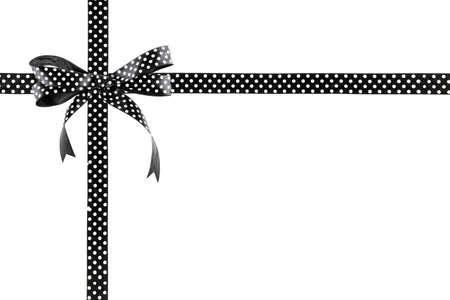 白い背景に弓で黒と白のリボン