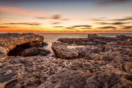 dramatic sunrise: Beautiful dramatic sunrise on the rocky beach