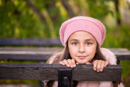 fall of the leaves: Adorable little girl outdoors at beautiful autumn day Stock Photo