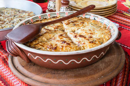 a portion: Potato pie with vegetables and cheese. Bulgarian national dish Stock Photo