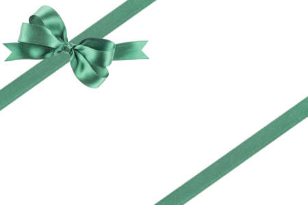 goodie: Green ribbon with a bow on white background Stock Photo