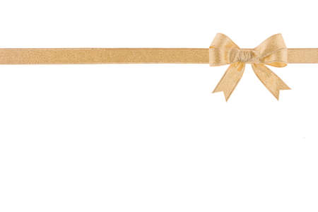 goodie: Golden ribbon with a bow on white background