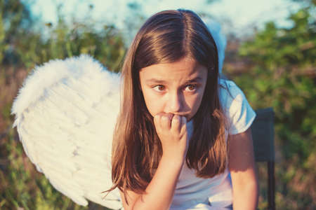 Little girl with angel wings and white dress - copy space Stock Photo
