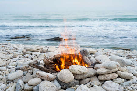 Fire on the beach - selective focus, copy space