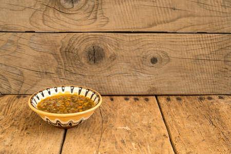 troyan: lentil soup over vintage rustic table - copy space