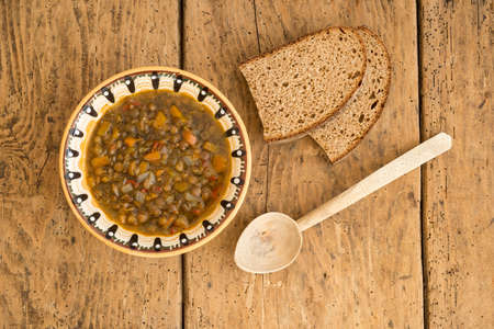 troyan: lentil soup over vintage rustic table - top view, copy space Stock Photo