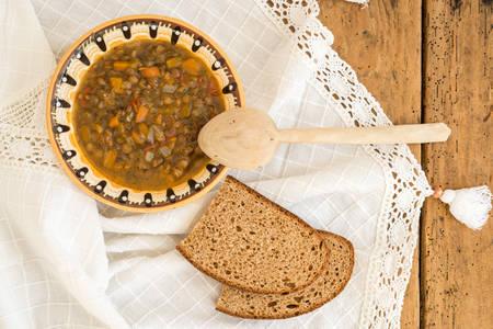 troyan: lentil soup over vintage rustic table - top view