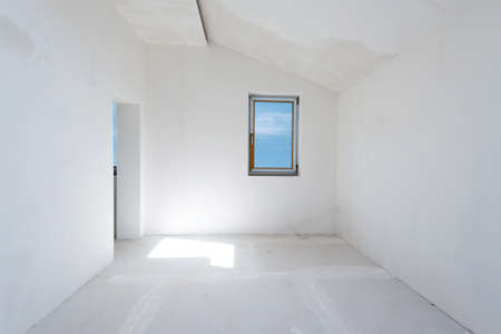 commercial painting: Unfinished building interior, white room with sky view